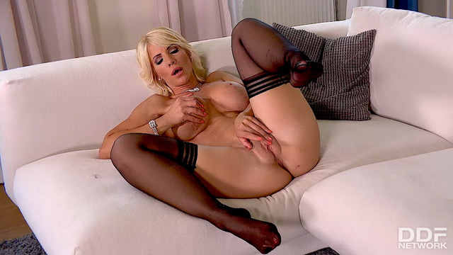Hot milf Tiffany Rousso treats to solo foot tease in shiny red pumps & stockings