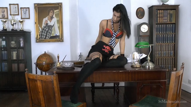 Naughty coed Roxy Mendez pets her fancy black opaques on the Headmistress's desk