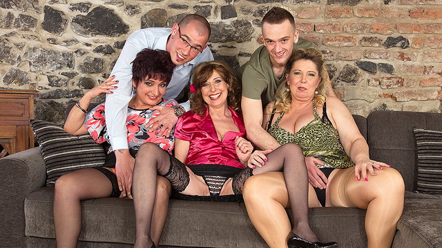 Three horny stocking-clad cougars go for a group fuck with two much younger guys
