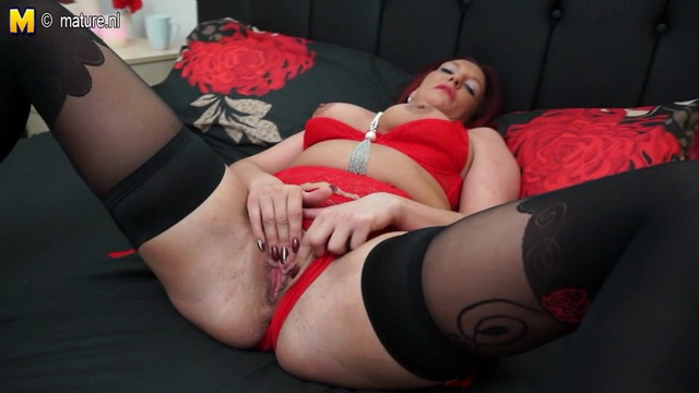 Fiery English housewife Francesca shows her red lace lingerie and legs in patterned stockings on cam