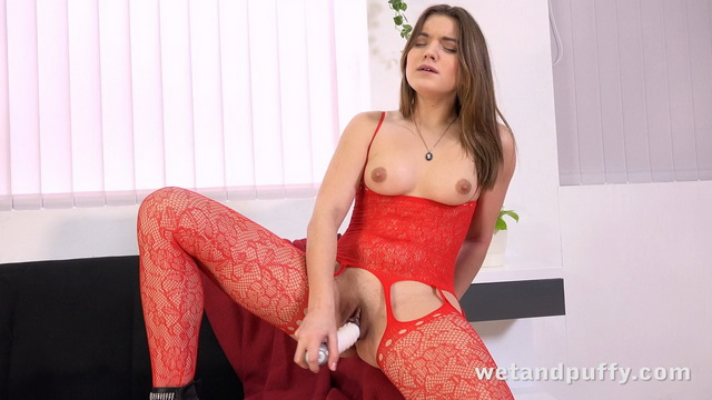 Evelina Darling dons a red lace bodystocking to try a number of toys on her pink