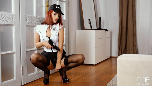 Dangerous police woman Aylin Diamond spreads long stocking-clad legs rubbing her cunt with a gun