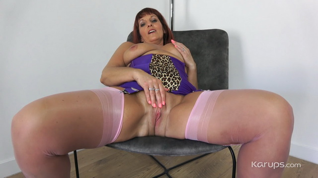 British lady Beau Diamonds slips a hand between her plump legs in pink stockings