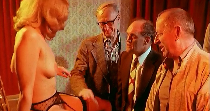 Black-stockinged German redhead masturbates before a group of men