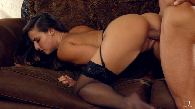 Nubile Amirah Adara wears strappy lingerie with stockings and heels for a bang