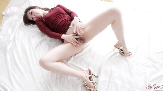 Japanese doll Tsubaki Katou shows a dark bush between her legs in golden heels