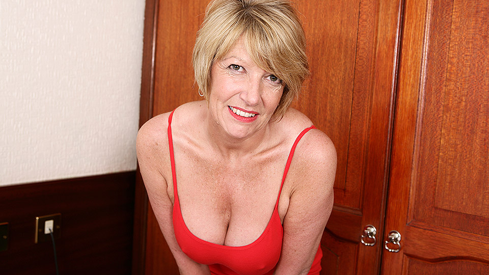 Busty milf with red dildo