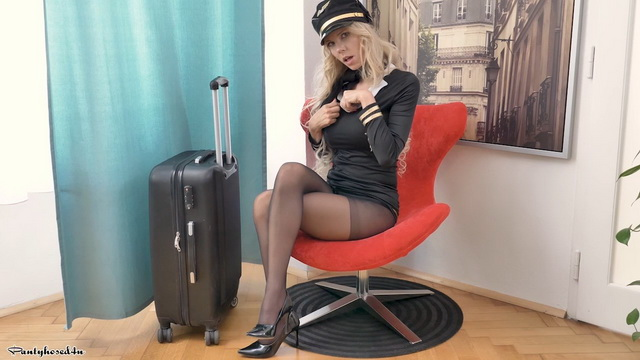 Hot blonde Florane Russell shows tasty curves in air hostess uniform and tights