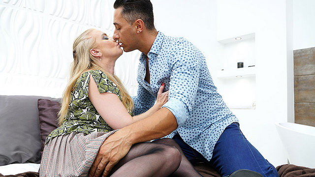 Insatiable UK mom Lily May nailed by a young man in her black nylons & red thong