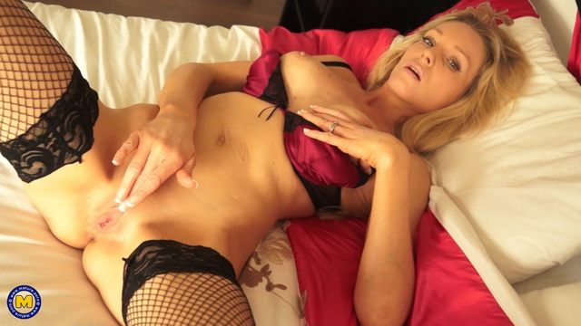 Blonde UK milf Angel Price dons a tartan skirt with raunchy fishnets for a toy