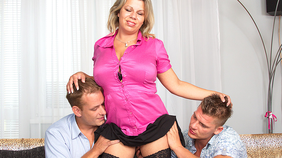 Big-boobed housewife cheats with two horny lads in a stockinged threesome