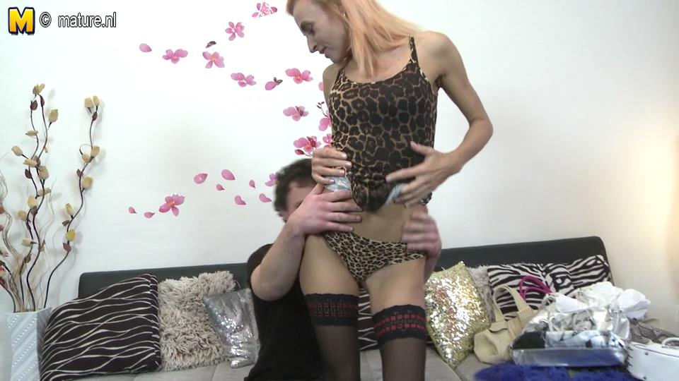 Skinny red-haired milf reveals leopard lingerie and black ribbon-trimmed holdups screwing a boy