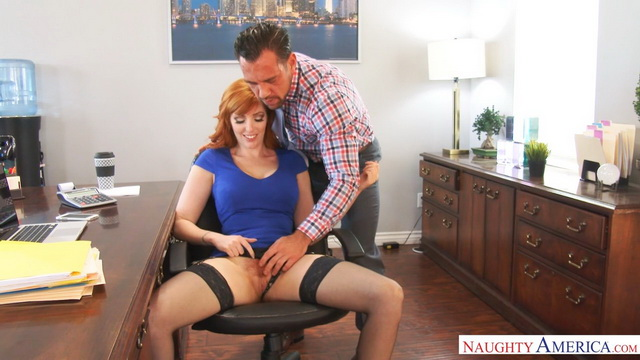 Overworked busty redhead Lauren Phillips spreads legs in black stockings for a fuck on the desk