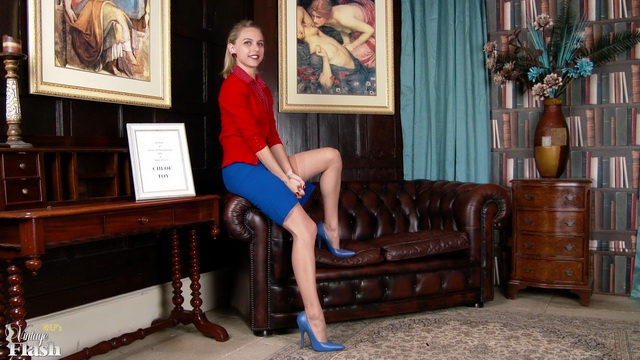 Blonde Brit Chloe Toy frigs with vintage panties hanging from her legs in tan nylons and blue pumps