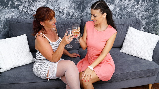 White-stockinged mom Beau Diamonds & Vicky Love eat pussy after a glass of wine