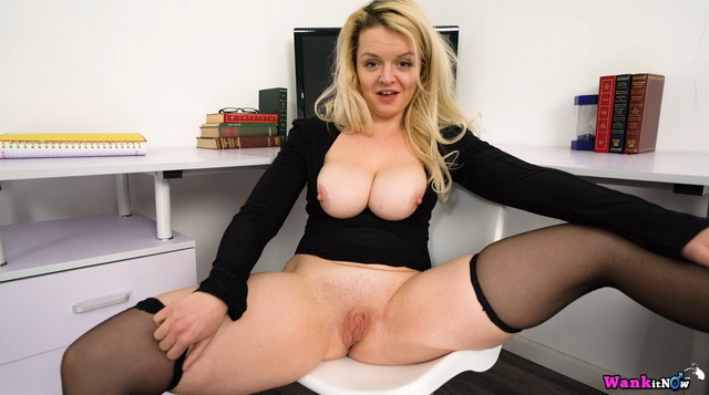 British blonde Bella bares big boobs and parts stockinged legs for office wank