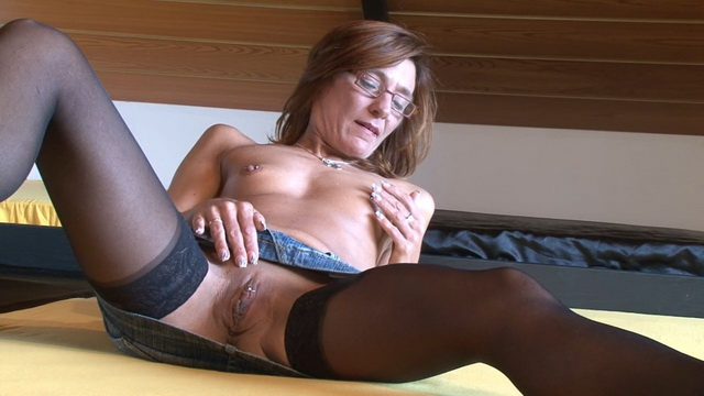 Skinny German amateur mature in glasses and stockings masturbates