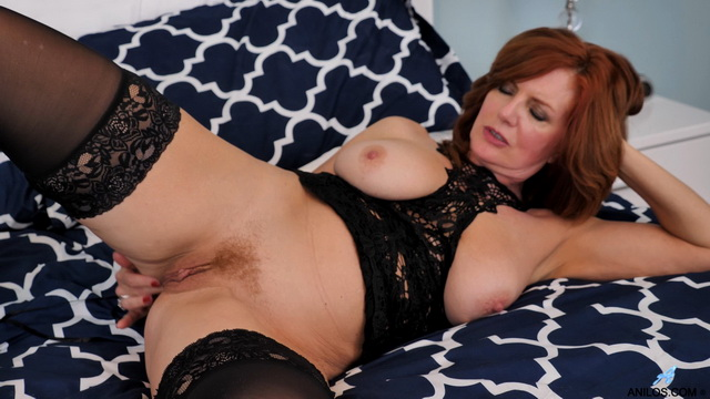 Bigtitted US mature Andi James parts legs in FF stockings and heels for solo play