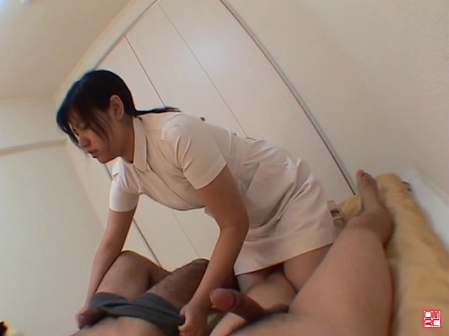 Tiny Japanese nurse in white nylons expertly drains two cocks in FMM