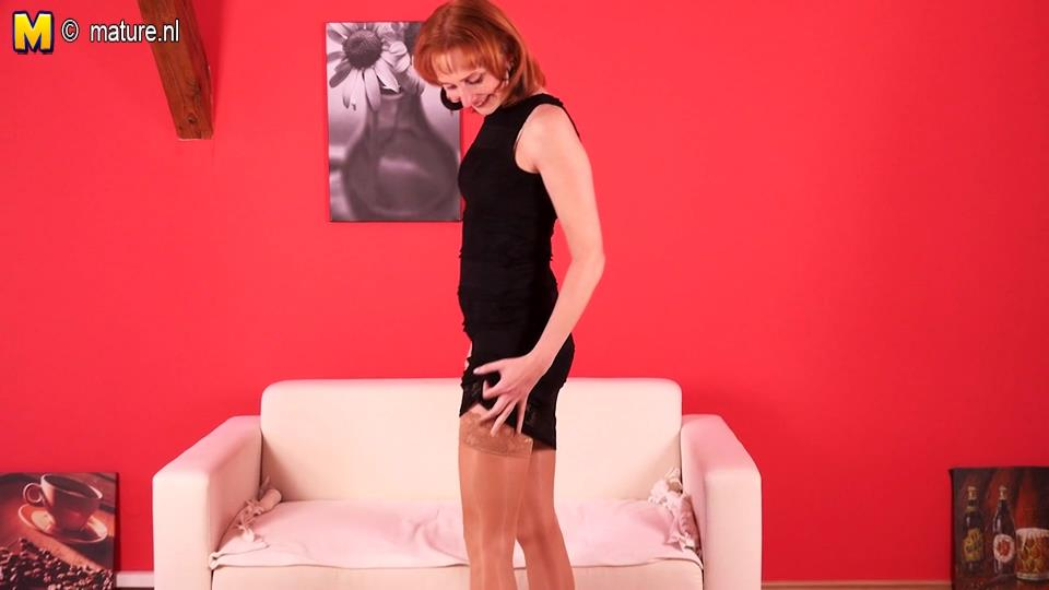 Skinny redheaded mature in popping out shiny suntan holdups enjoys her solo playtime to the full