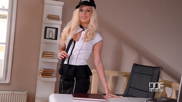 Blonde lady-cop Candee Licious in popping out black lacy stockings fucks herself with a handy baton