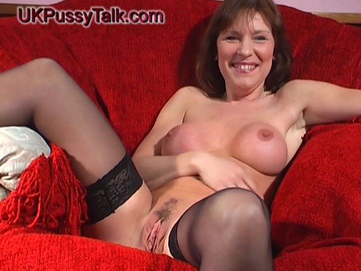 British mom Wendy Taylor strips to her sexy red lingerie and black holdups for an explicit sex talk