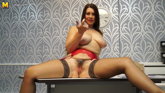 Elegant British office milf Christine O. takes a break flashing her red lingerie and black stockings