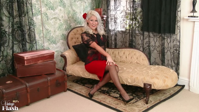 British lady in retro lingerie and stockings Lu Elissa is feeling very horny on the chaise