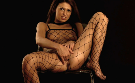 Heated babe fingering her pussy thru her black net bodystocking