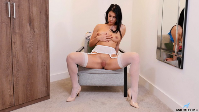 Hot UK milf Roxy Mendez gets dirty in white gartered stockings and blue lingerie