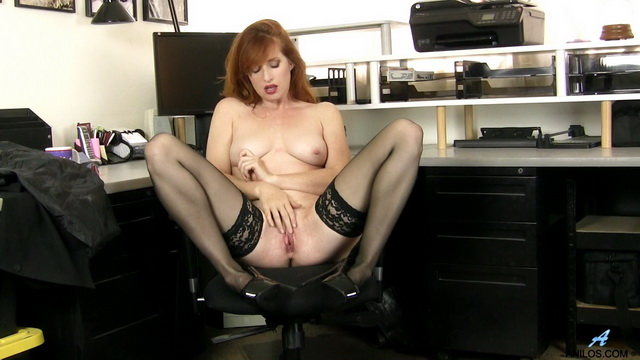 US milf Amber Dawn frigs in the office spreading stockinged legs and dangling and dropping her heels