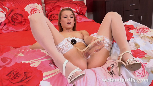 Victoria Daniels shows off her pretty white lingerie and lacy stockings using her pussy pump and bat