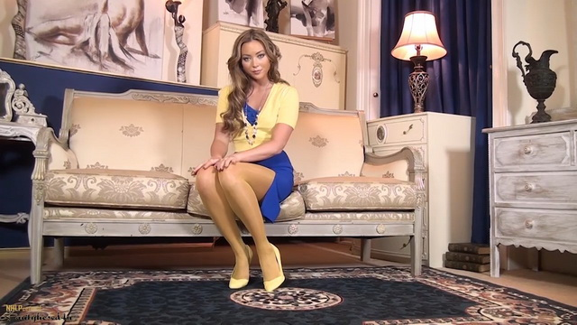 Frisky show-off Natalia Forrest fingers in her shiny yellow pantyhose and pumps
