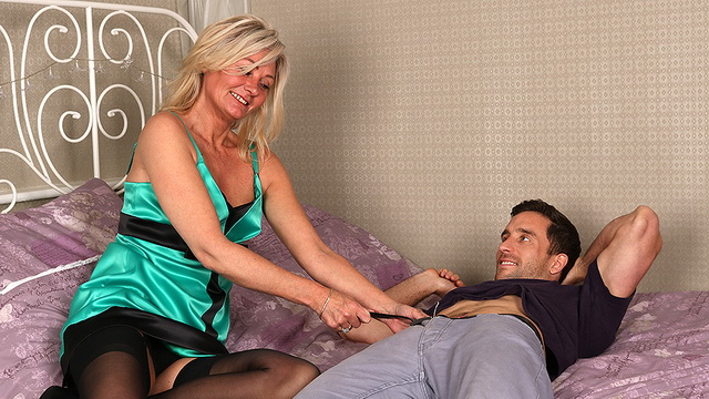 Hairy British mom Ellen B. gets all dolled-up complete with black nylons and garters for a young dick