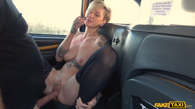 Smart blonde milf Angel Cruz reveals her tats and stockings fucking in the taxi