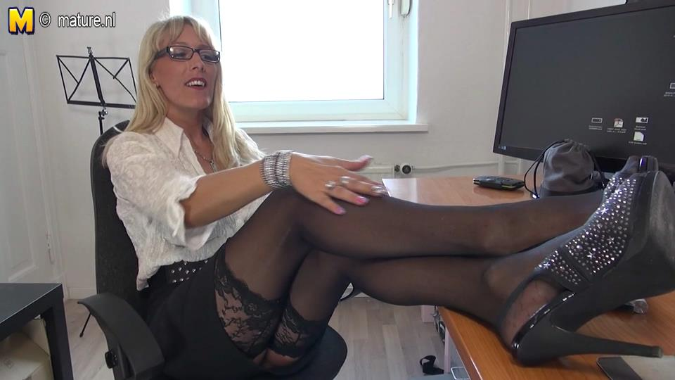 German office mature Lana strokes her sleek stockinged legs and oils big boobs for some solo play