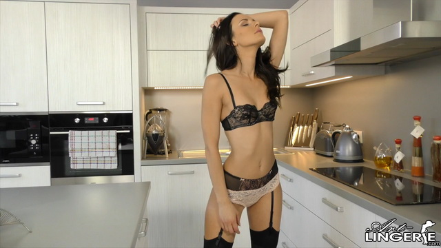 Slim-bodied Kate Sin aka Kira Peterson struts in her sexy black lingerie and stockings in a kitchen