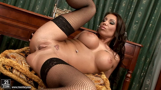 Seductive busty secretary Candy Strong enjoys dildo DP in her rhinestone heels and black fishnets