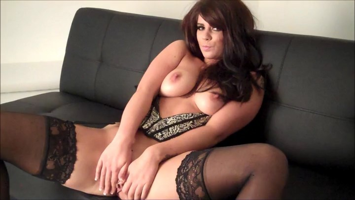 Busty British minx Kandie Luv clad in a luscious corset set with gartered stockings frigs her beaver