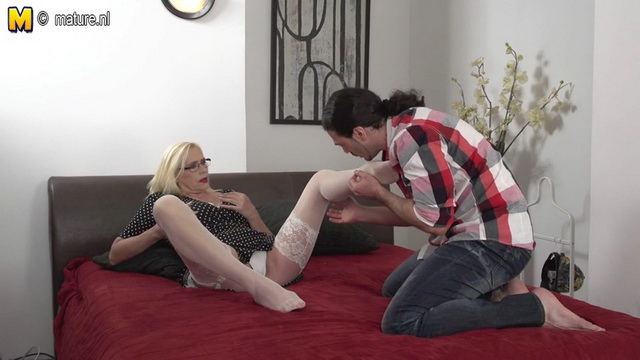 Spectacled blonde mommy gets her legs in sheer white stockings worshipped and her hairy muff stuffed