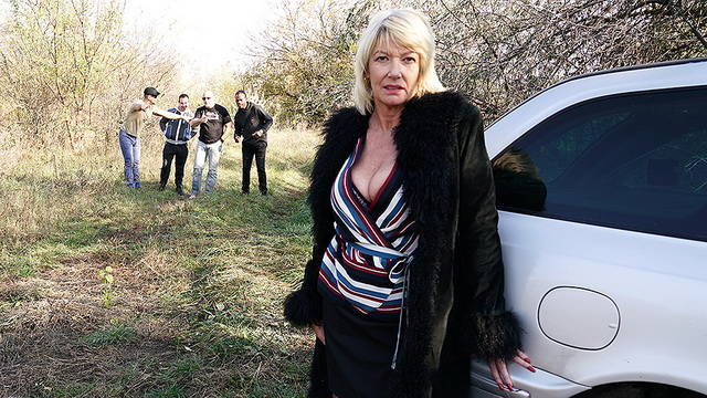 Mature Brit Amy Goodhead makes outdoor selfies before a stockinged all-out orgy