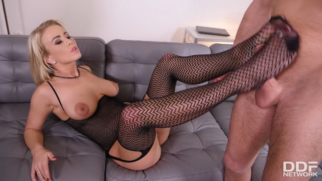 Footsy babe Licky Lex gives a footjob in her matching patterned nylons & corset