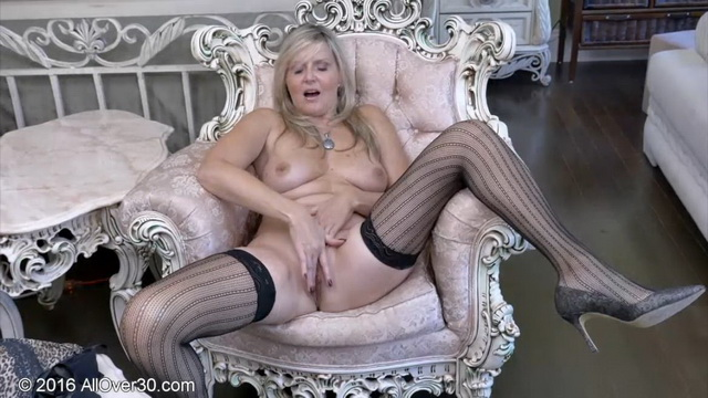 Horny blonde mature Velvet Skye strips her leopard panties and bra to squirt in stripy mesh holdups