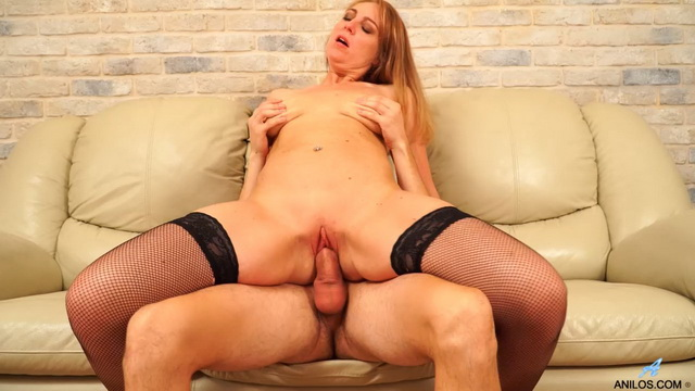 Cock-hungry mature Marta milks a cute youngster opening legs in black fishnets