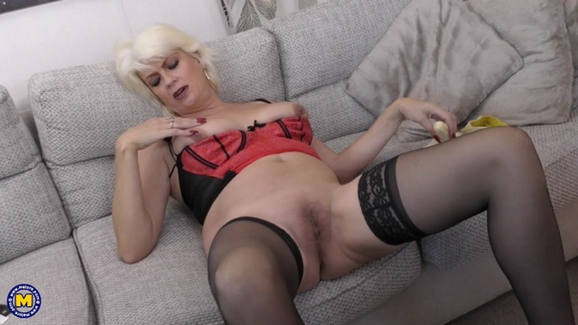 Horny British mature Dimonty fucks a banana in her red corset and black stockings