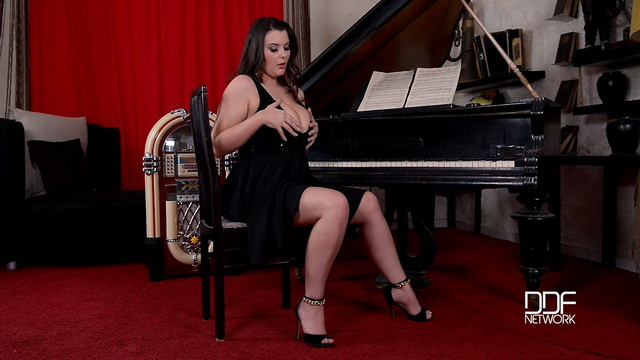 Curvaceous Brit Cherry Blush takes out giant boobs and sings her orgasm by the piano in high heels