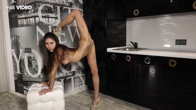 Super-flexi brunette Inessa Sabchak makes sexy splits and spread-eagles in her lacy thong and wedges