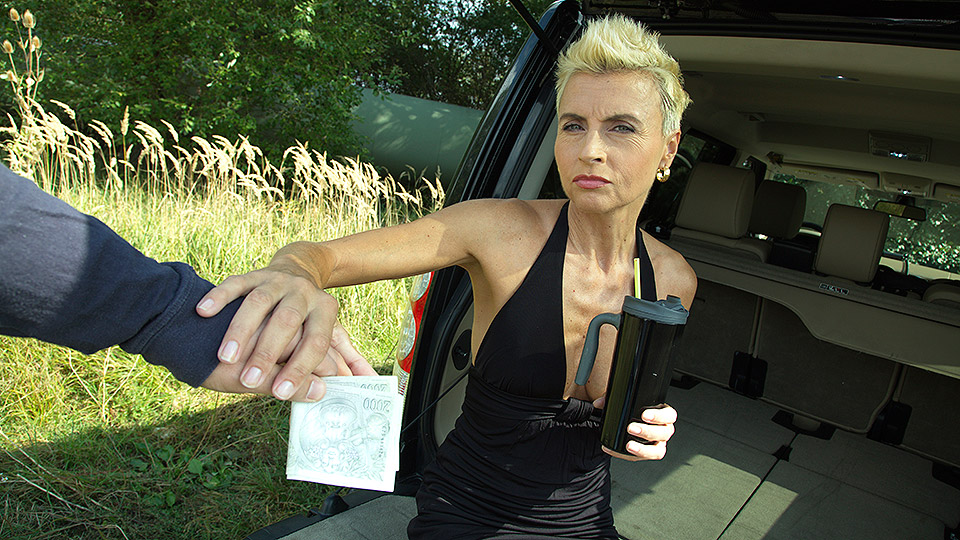 Slim blonde mature in suntan stockings flashes her boobs and gets fucked POV style by the car