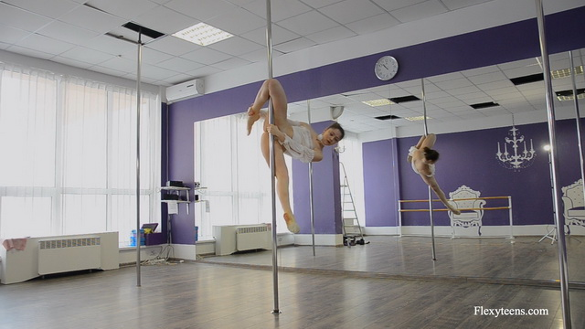 Irina Brovkina peels her white G-string after a sexy pole dance for a fully nude flexi performance