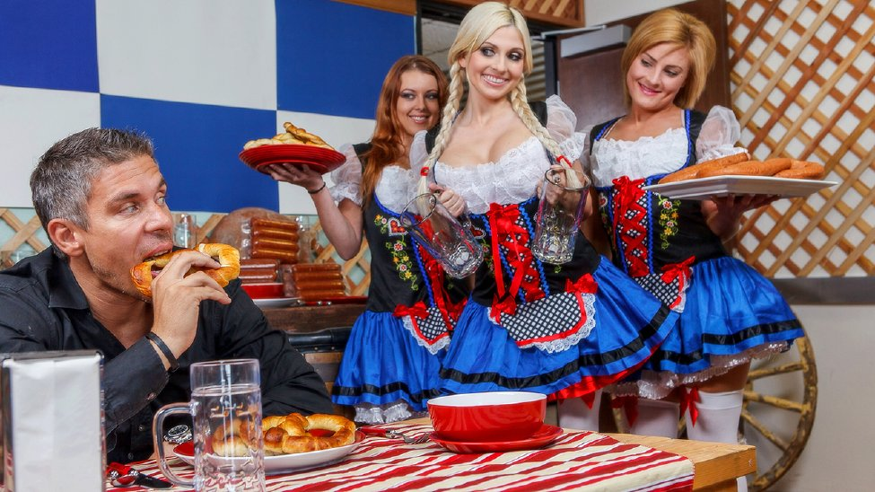 Costumed and stockinged beer girls compete for a big fat sausage